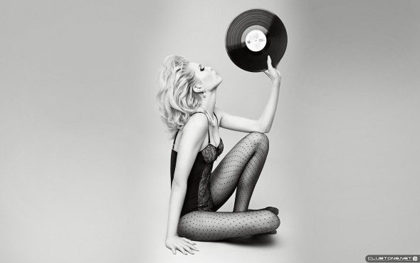 girl with vinyl on the white background предпросмотр