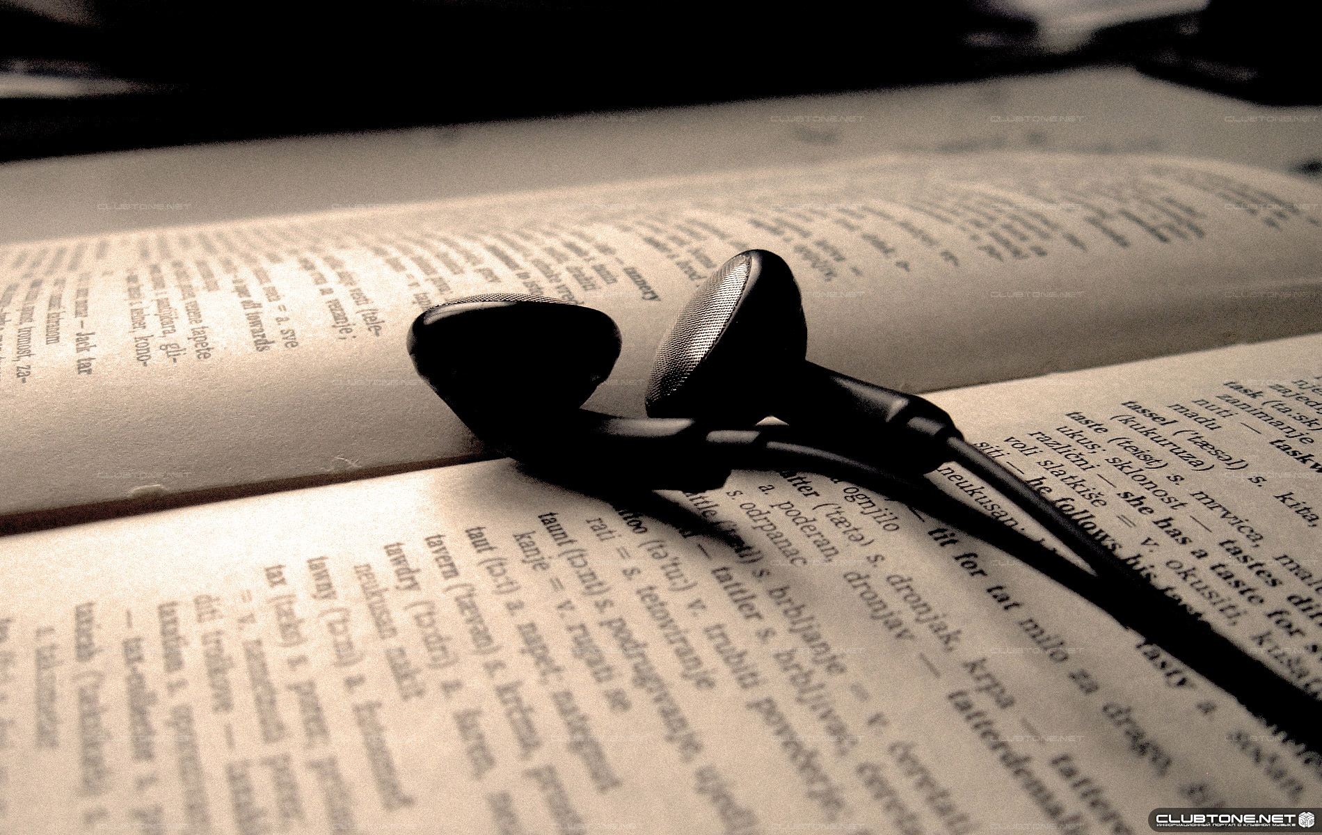 headphones on the book