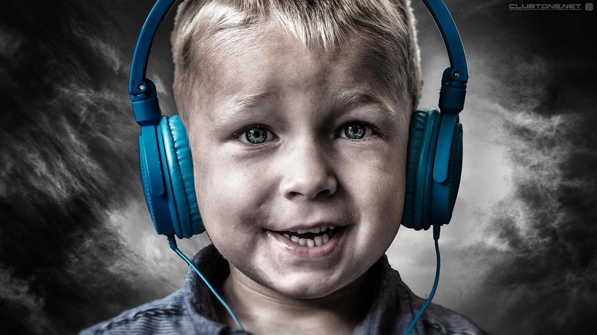 blue-eyed boy with blue headphones