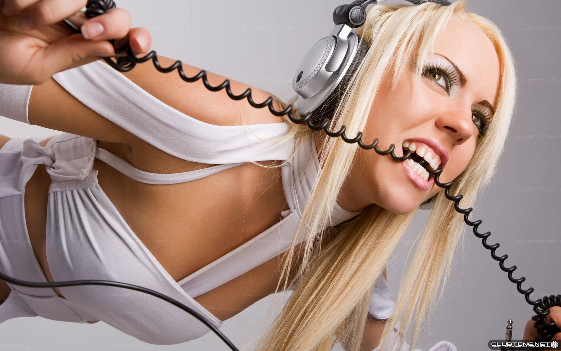 girl in headphones with a wire